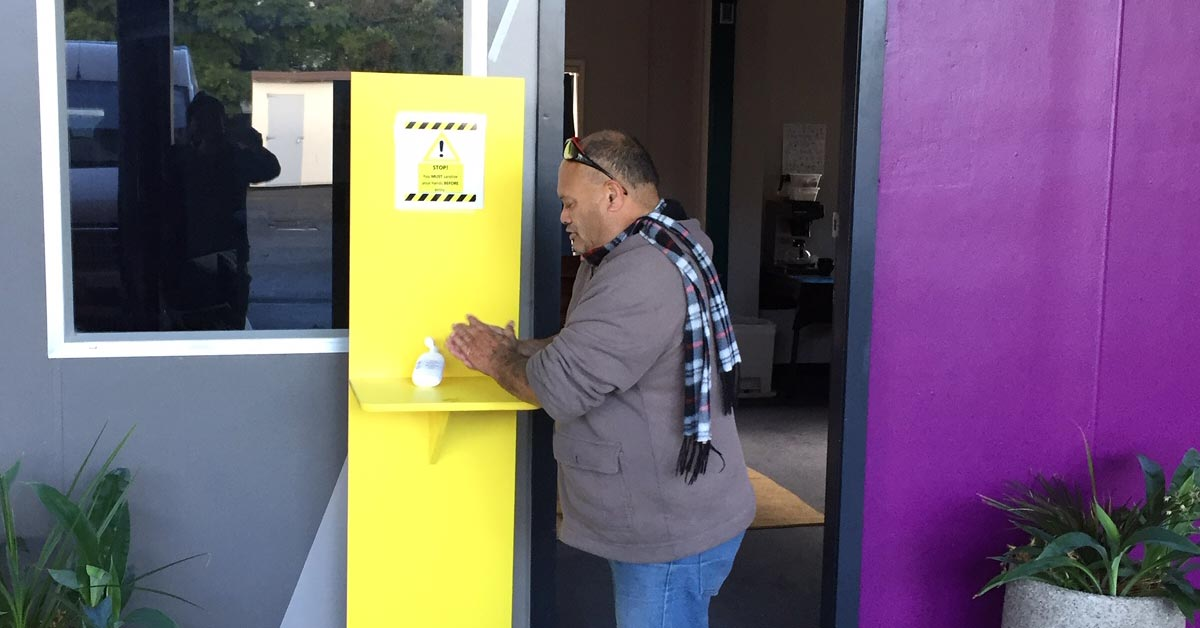 NorthTec staff work together on campus hygiene stations
